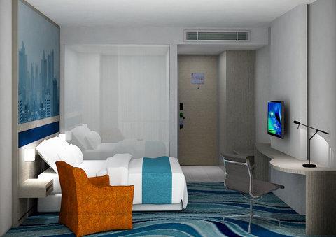 Bedroom of Holiday Inn Express Jakarta Cikini