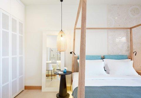 Upbeat Retreat Guest Room - Sleeping Area