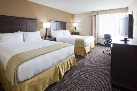 Our room with two queen beds can sleep up to four