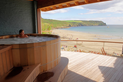 Sheltered outdoor hot tub has commanding views ove